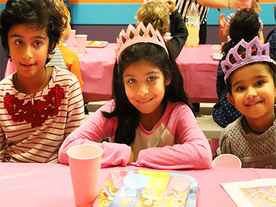 Girls patiently awaiting their food at the Best Children's Birthday Party Place.